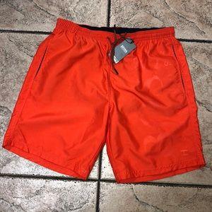 Hugo Boss men's swim trunks with tags.